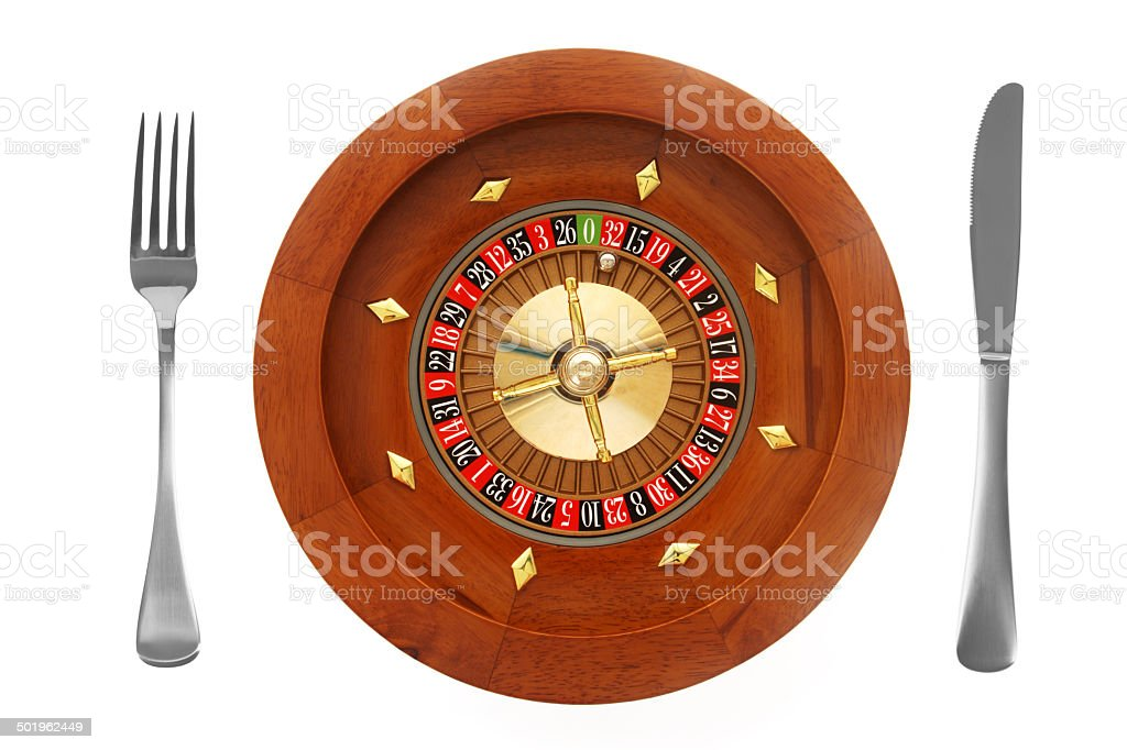 Roulette Wheel with Knife and Fork on White Background stock photo