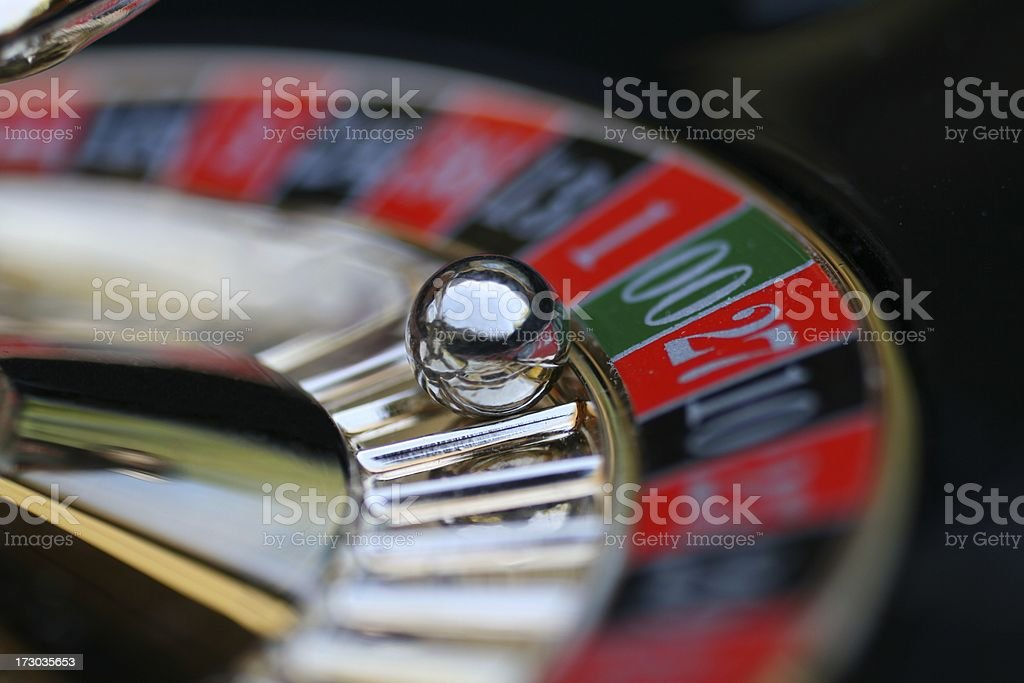 A roulette wheel with the ball on 00 spinning roulette wheel with selective focus on ball landed on double zero.   Blurred Motion Stock Photo