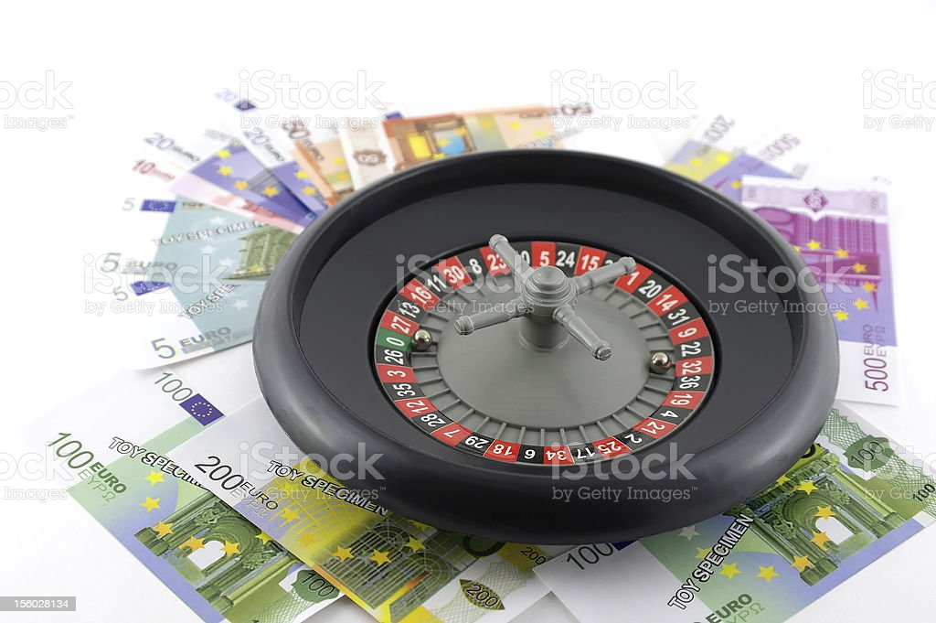 Roulette with money over white royalty-free stock photo