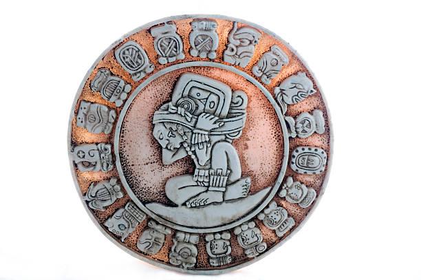Round ancient Aztec Mayan calendar composed of many symbols stock photo