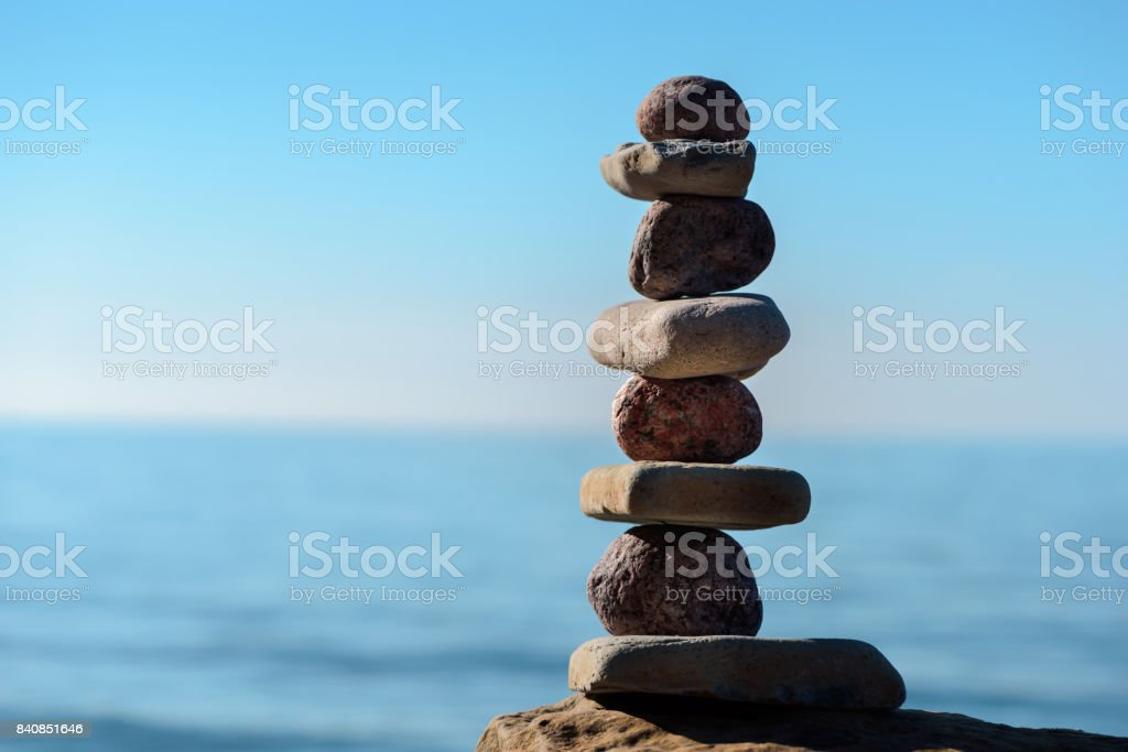 Round and flat stones stock photo
