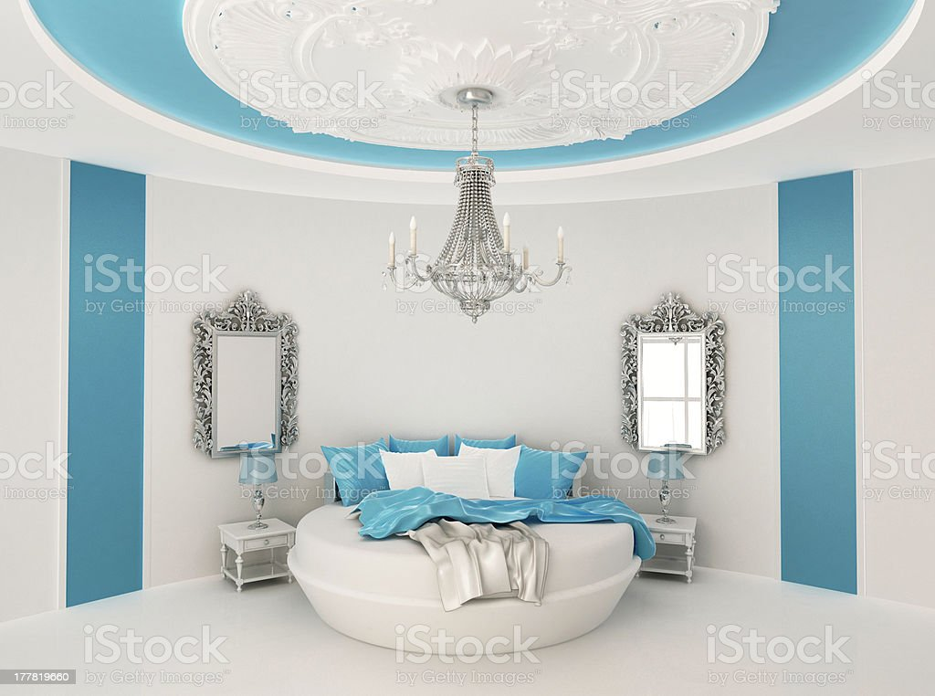 Round bed in baroque interior. Luxurious furniture stock photo