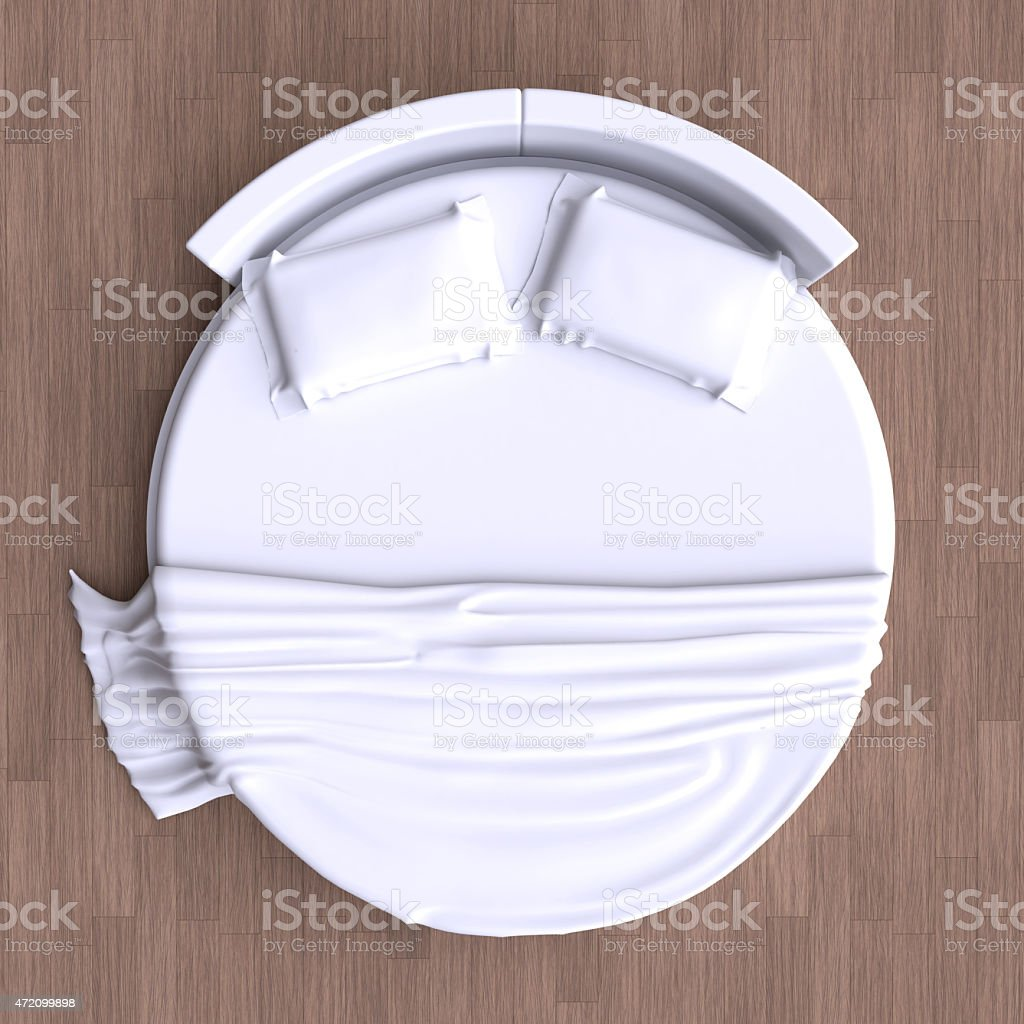 Round bed with pillows on the floor in the room. stock photo