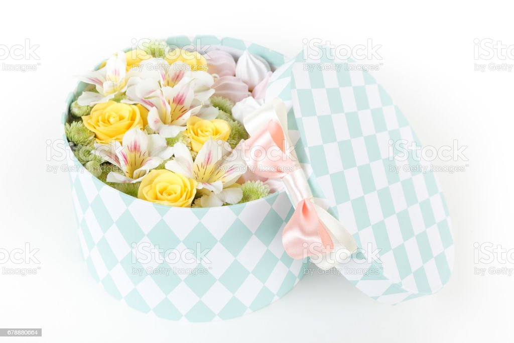 Round box with fresh flowers and meringue cookies royalty-free stock photo