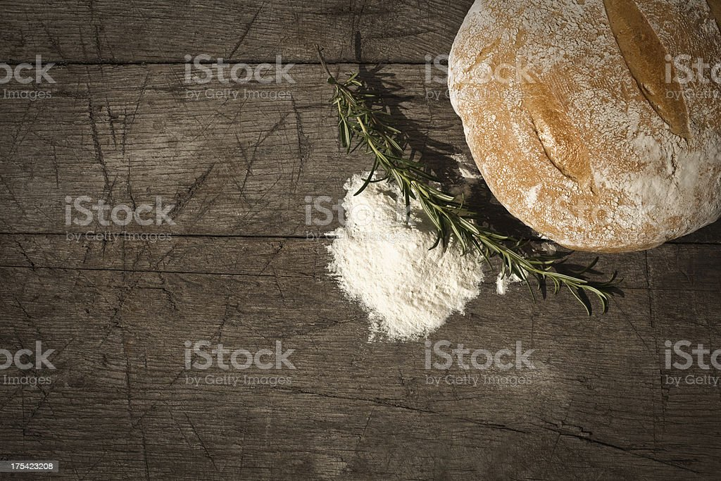 Round Bread On A Wooden Table stock photo