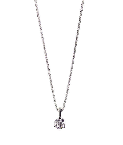 Round brilliant Diamond solitaire Pendant necklace on a chain A beautiful diamond and white gold pendant dangles from a chain. Fine Jewelry necklace isolated on a white background with shadow and reflection amulet stock pictures, royalty-free photos & images