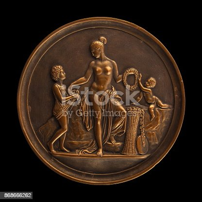 istock round bronze painting of a nude woman 868666262
