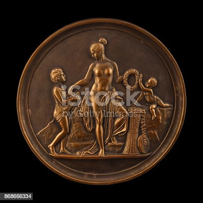istock round bronze painting of a nude woman 868666334