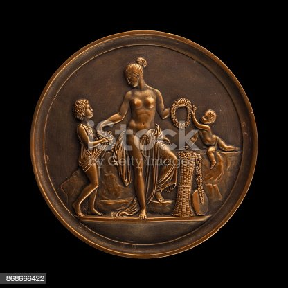 istock round bronze painting of a nude woman 868666422
