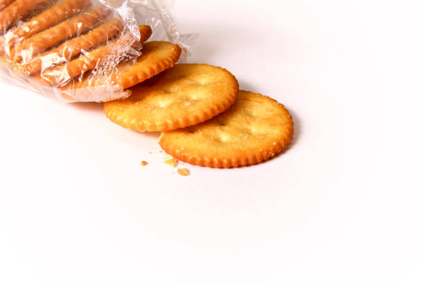 round butter crackers in open package stock photo