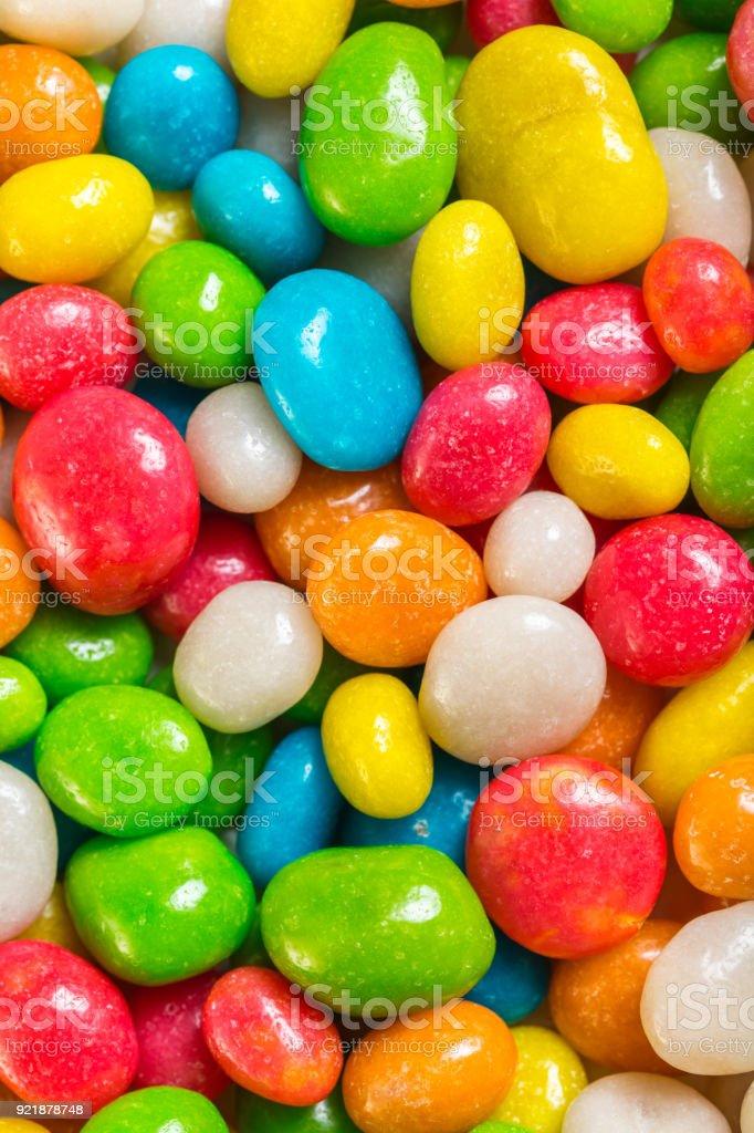 round candy in multicolored glaze stock photo