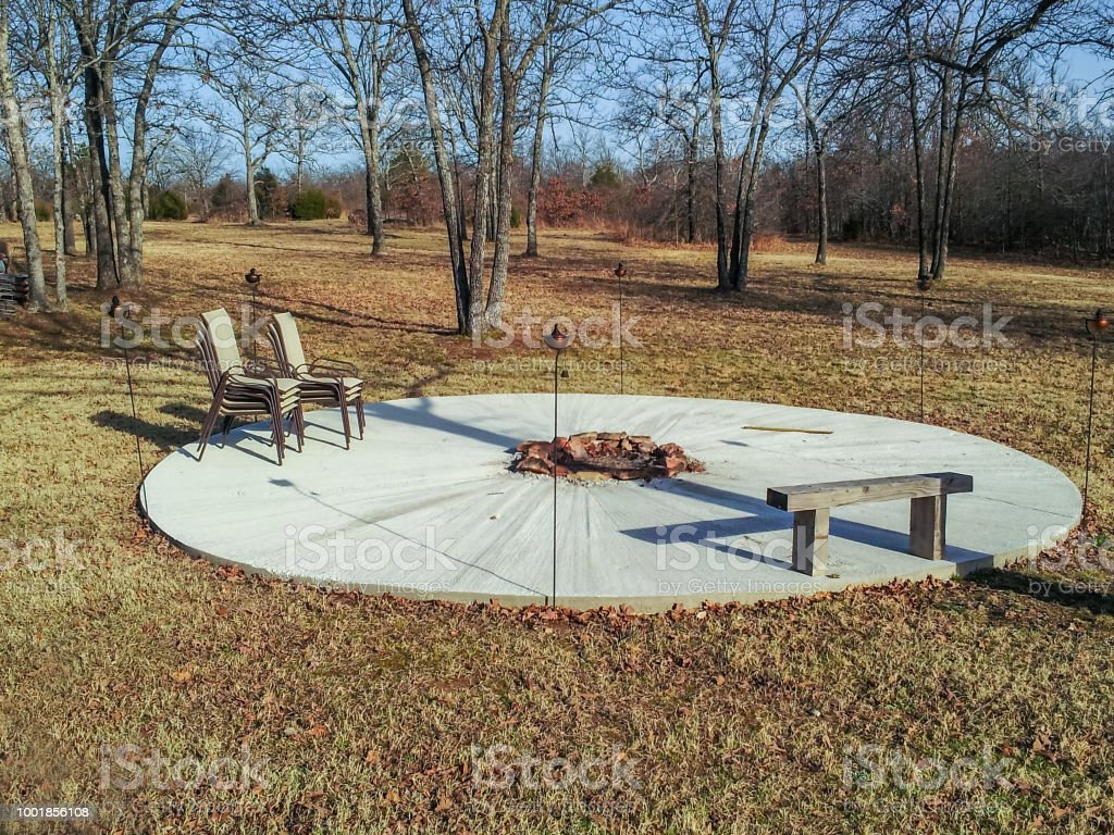 Amazing A Round Cement Patio With A Fire Pit In The Middle And A Machost Co Dining Chair Design Ideas Machostcouk