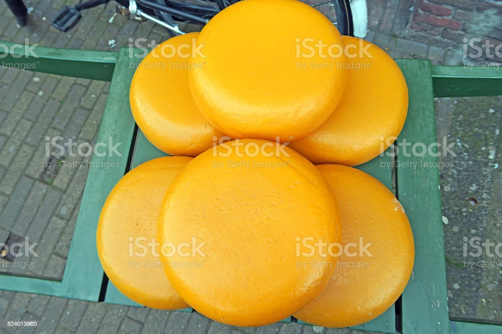 Round cheese blocks on display in store front- Netherlands stock photo