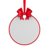 istock round christmas label with red ribbon and bow on white background. Isolated 3D illustration 1270364502