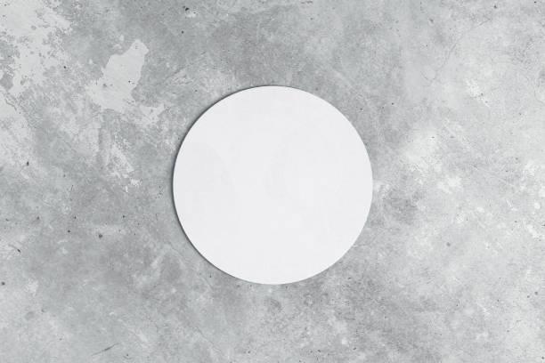 Ronde Onderzetter op concrete achtergrond foto