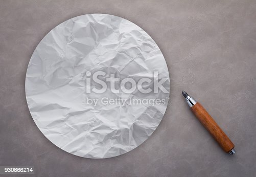 round crumpled paper with wooden pencil