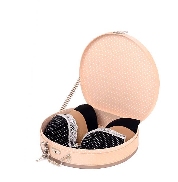 Round cute opened box with three sexy bras. stock photo