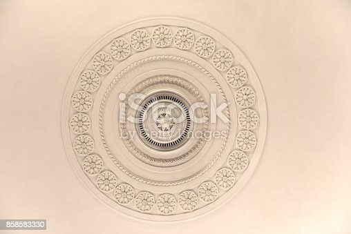istock Round decorative plaster stucco relief molding with floral ornaments 858583330