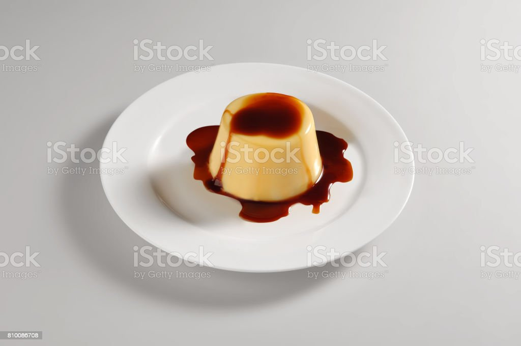 Round dish with caramel creams stock photo