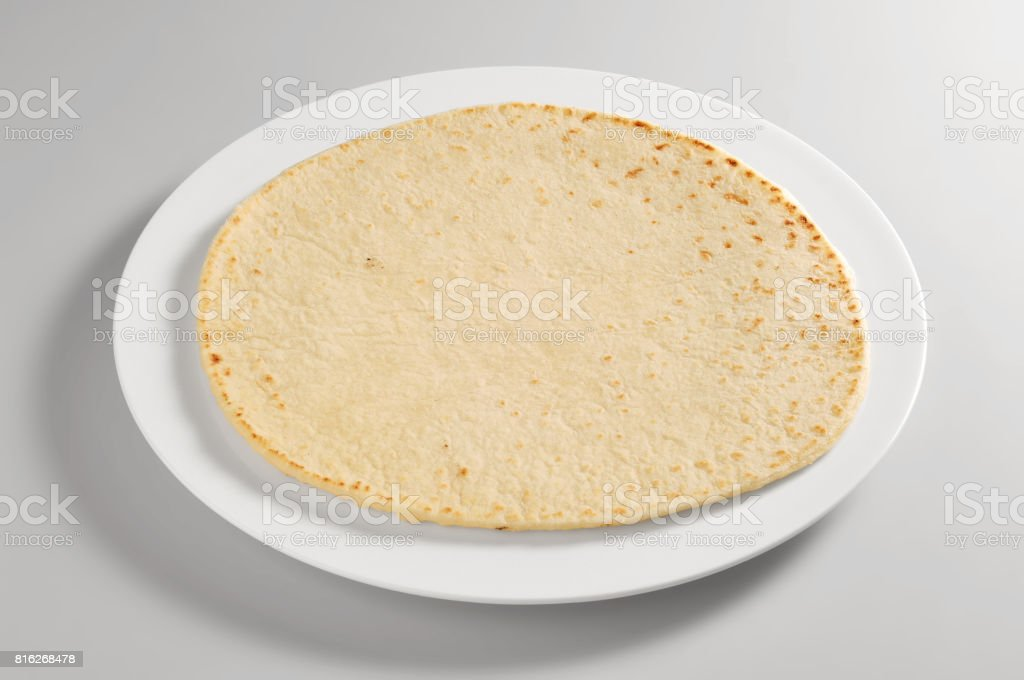 Round dish with piadina bread stock photo