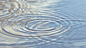 istock Round droplets of water over the circles on the water. Ripples on sea texture. Closeup water rings 1227596048