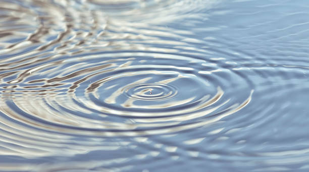 Round droplets of water over the circles on the water. Ripples on sea texture. Closeup water rings Round droplets of water over the circles on the water. Ripples on sea texture. Closeup water rings rippled stock pictures, royalty-free photos & images