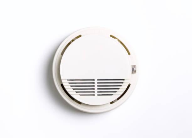 Ronda de alarma de incendio alarma de humo aislado en blanco - foto de stock