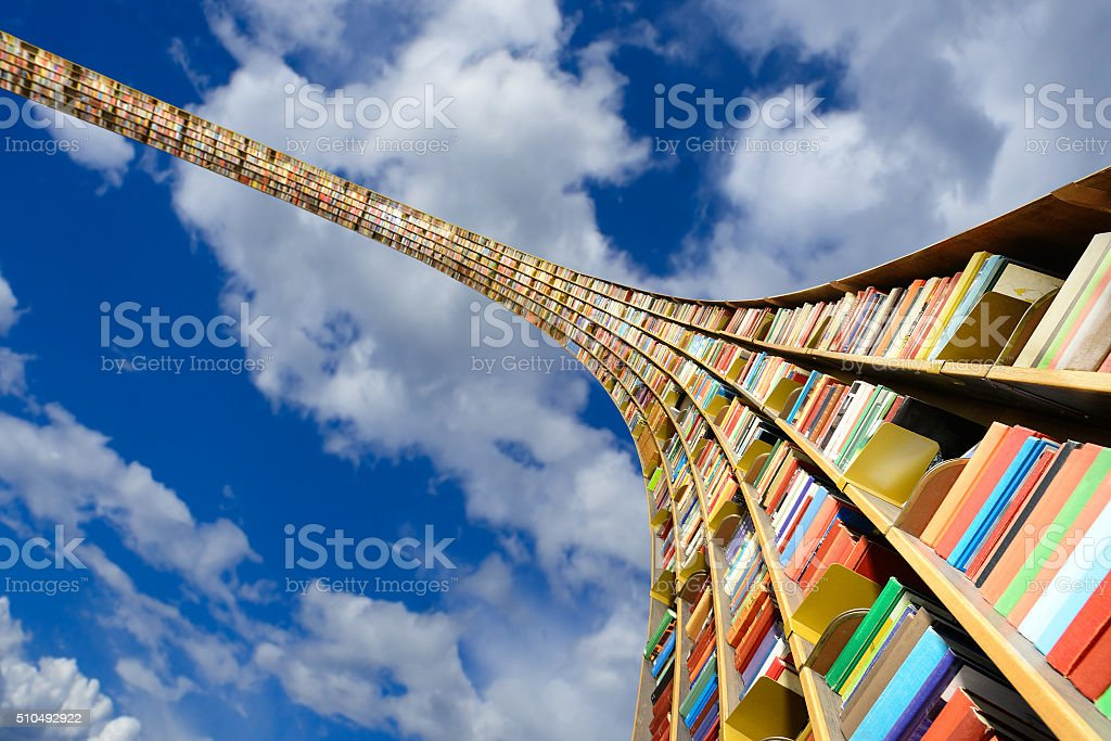 Round flying bookshelf against blue sky stock photo