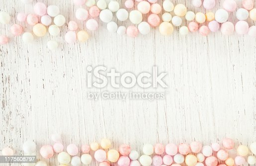 945748362istockphoto Round foam beads, minimal style composition pastel colored on white wood. 1175608797