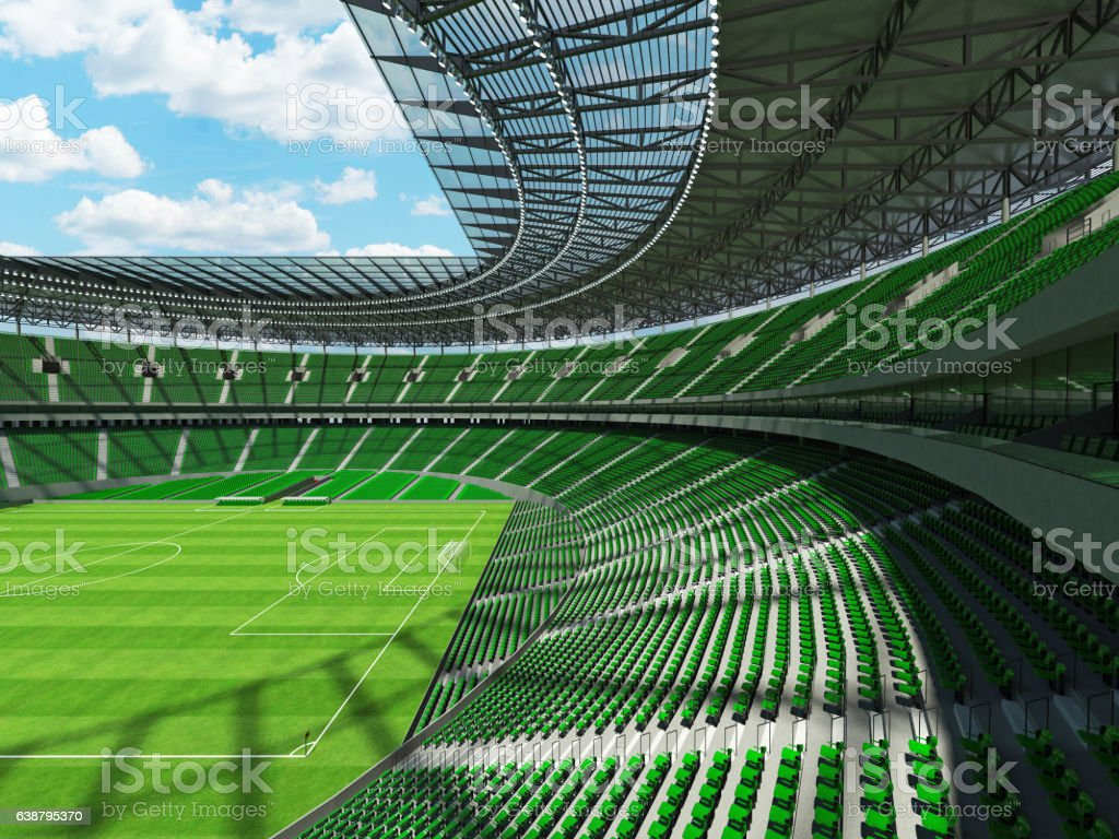 Round football -  soccer stadium with  green seats stock photo