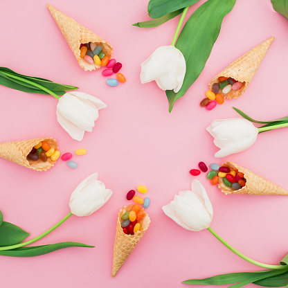 Round Frame Made Of Colorful Bright Candy In Waffle Cones And White Flowers On Pink Background Flat Lay Top View Stock Photo - Download Image Now