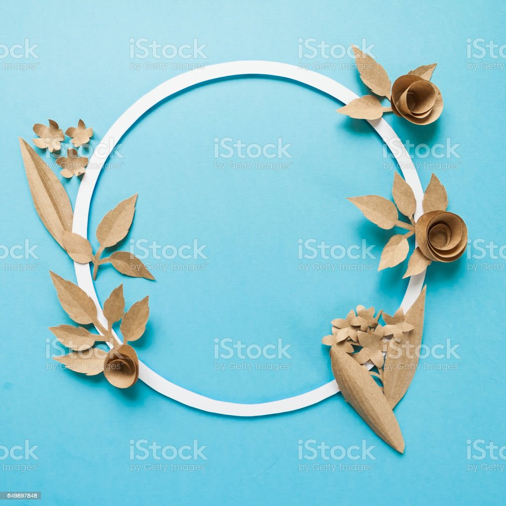 Round frame with craft paper flowers on the blue background flat lay round frame with craft paper flowers on the blue background flat lay nature concept mightylinksfo