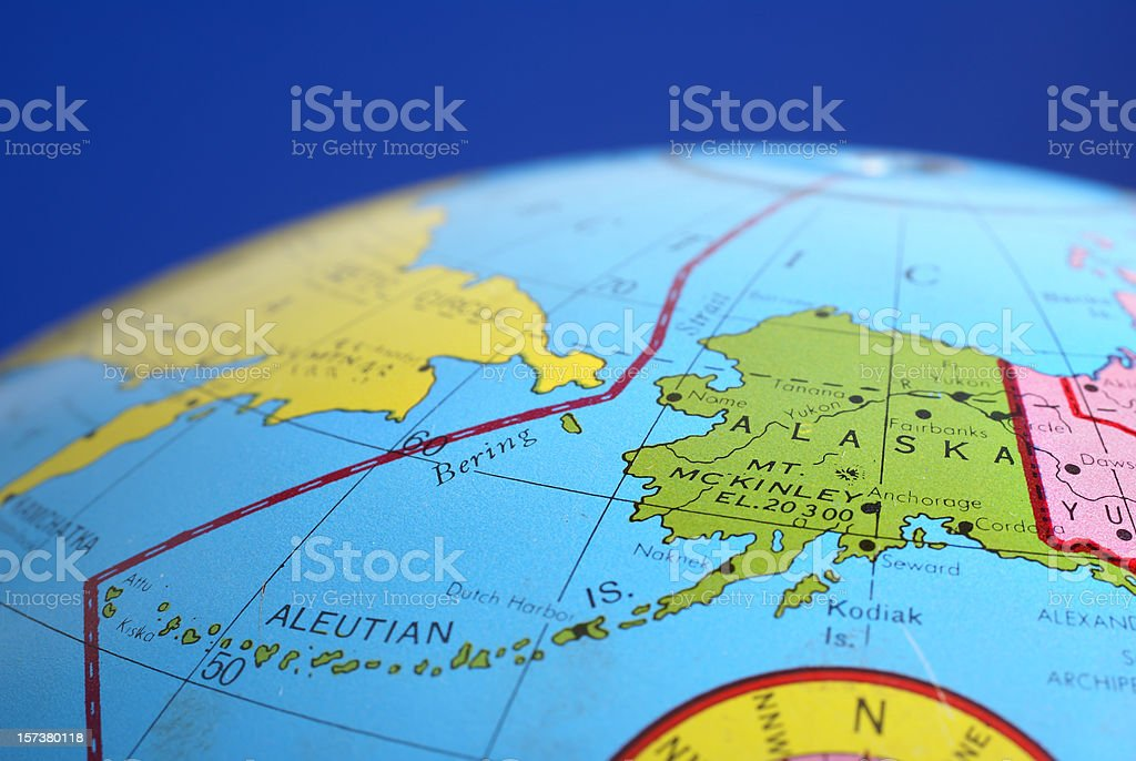 A round globe focused on Alaska. stock photo