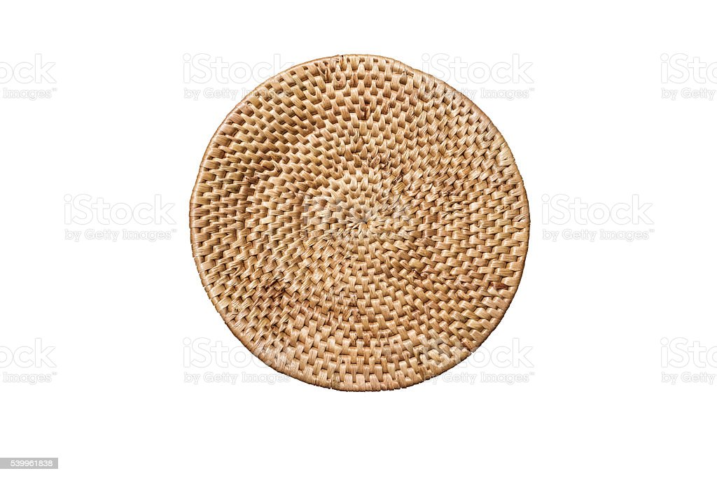 Round handmade weave rattan tray, isolated on white background stock photo