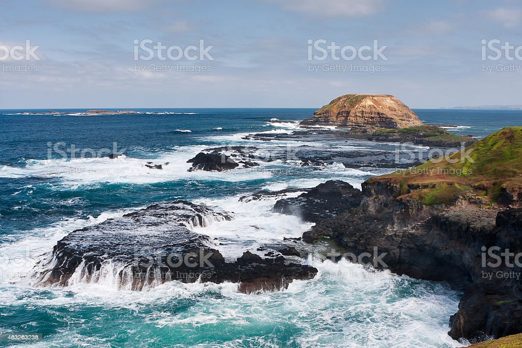 Round Island with crusing waves, Nobbies, Phillip Island, Austra stock photo