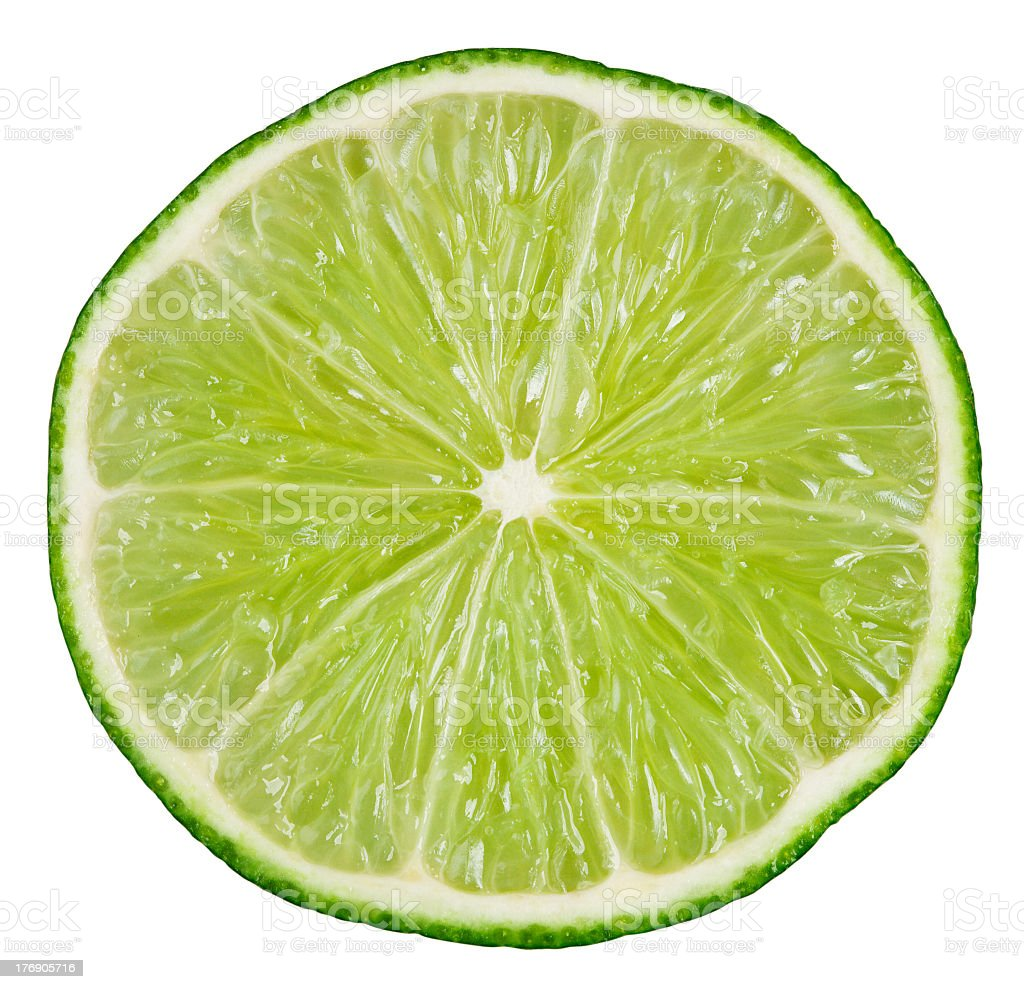 Round lime slice on a white background stock photo