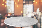 istock round marble table top with cafe restaurant bokeh lights abstract background for montage product display 1147656638