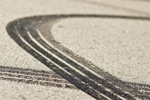 Round mark Close-up of several tire skid marks on asphalt tire track stock pictures, royalty-free photos & images