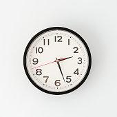 istock Round metal clock on white wall 1221699998