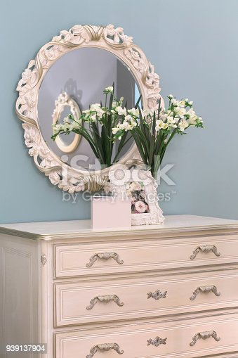 1136239089 istock photo Round mirror in beautiful white carved wooden frame. 939137904