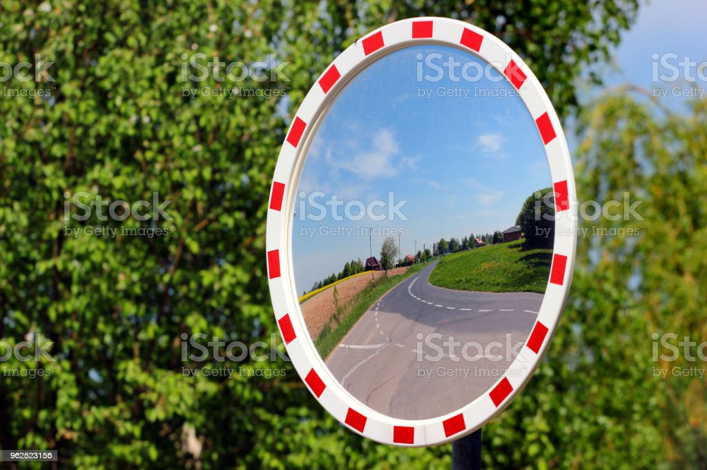 Round mirror on a country road - Royalty-free Car Stock Photo