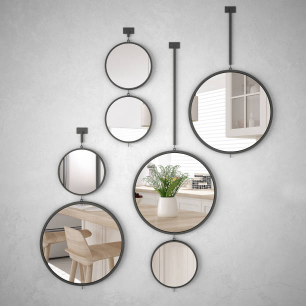 Round mirrors hanging on the wall reflecting interior design scene, minimalist white kitchen, modern architecture stock photo