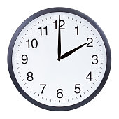istock Round office clock showing two o'clock isolated on white background 1204156637