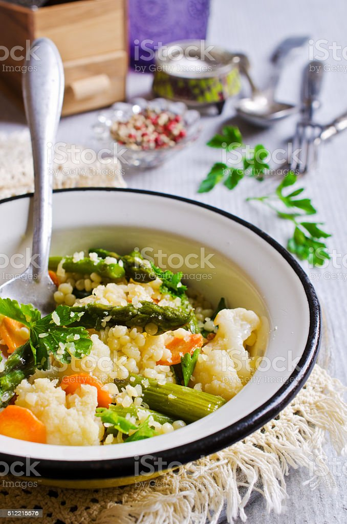 Round pasta with vegetables stock photo