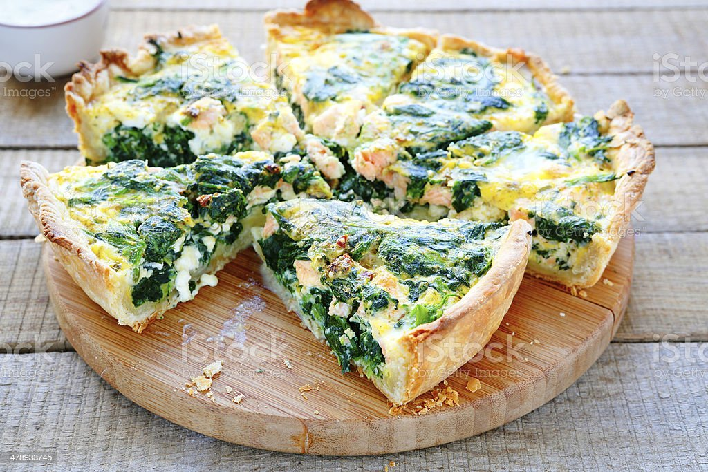 Round PIE with spinach and fish stock photo