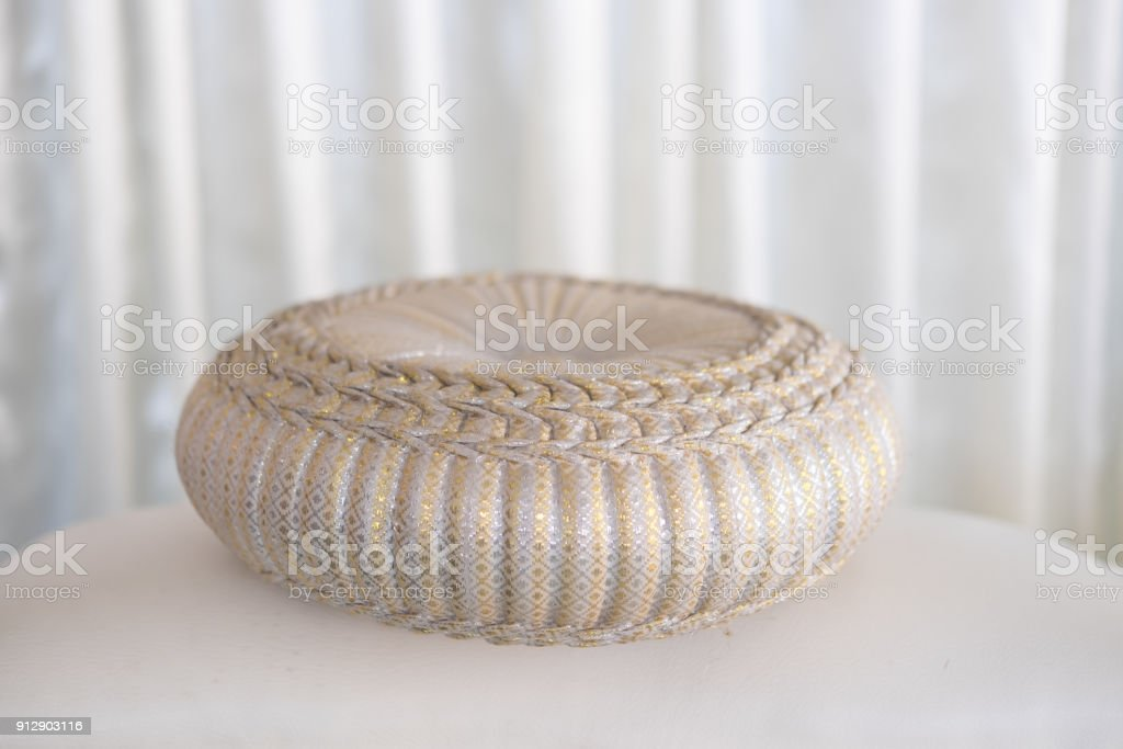 Round pillow for wedding for relaunch ceremony, wedding concept stock photo