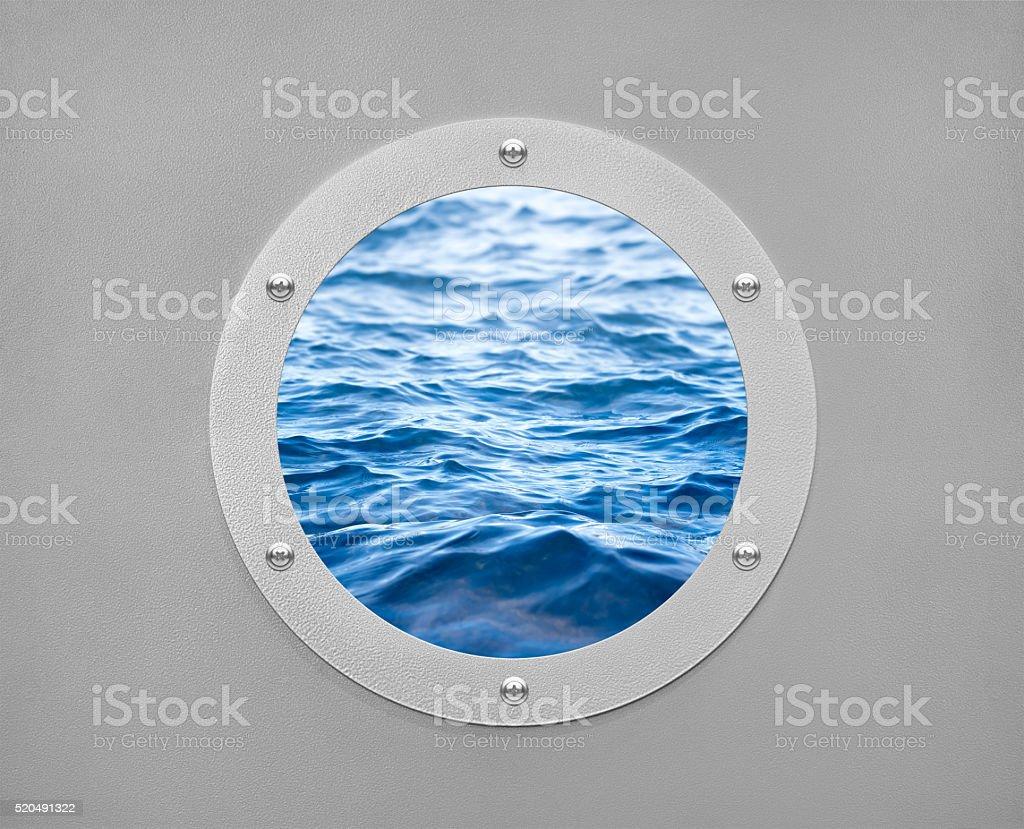 round porthole and sea wave stock photo