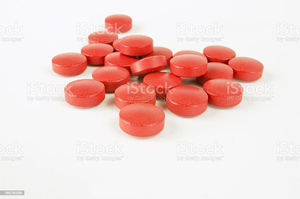 Round Red Pills on White stock photo