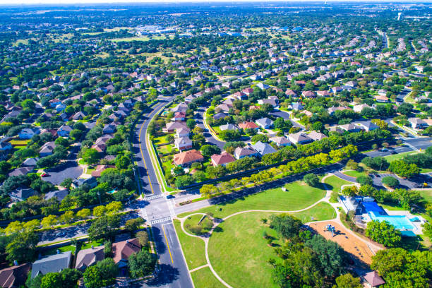 Round Rock , Texas , USA aerial drone view high above Suburb Neighborhood at park Homes stock photo