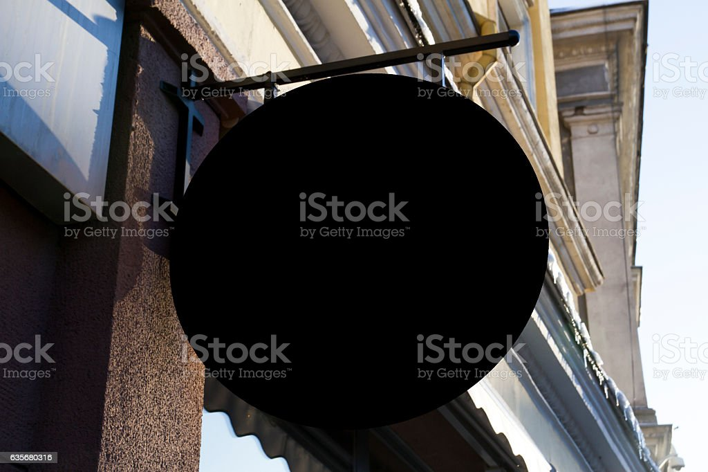Round shape Signboard on wall. Mock up stock photo